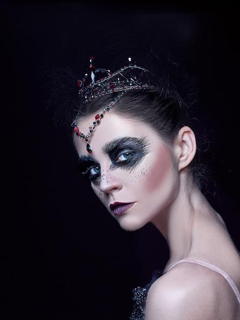 Portrait of ballerina as swan on black Free Photo