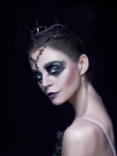 Portrait of ballerina as swan on black Free Photo