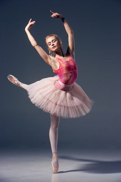 Portrait of the ballerina in ballet pose Free Photo