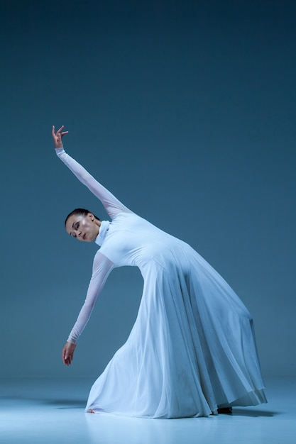 Portrait of the ballerina on blue wall Free Photo