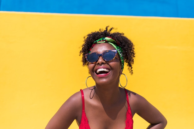 Portrait of beautiful afro american woman hands on face while smiling Premium Photo