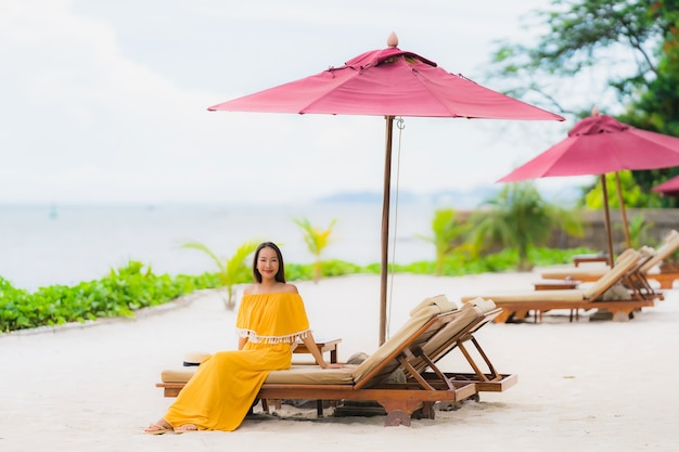 Portrait beautiful asian woman wear hat with smile happy leisure on the beach sea ocean in holiday vacation Free Photo