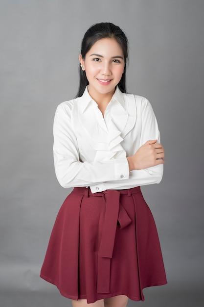 Portrait of beautiful  business woman on grey background, studio shot Premium Photo