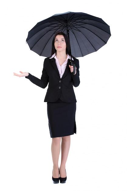 Portrait of a beautiful business woman holding a umbrella. Premium Photo