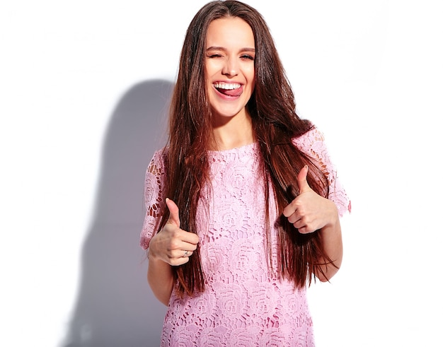 Portrait of beautiful caucasian smiling brunette woman model in bright pink summer stylish dress isolated on white background Free Photo