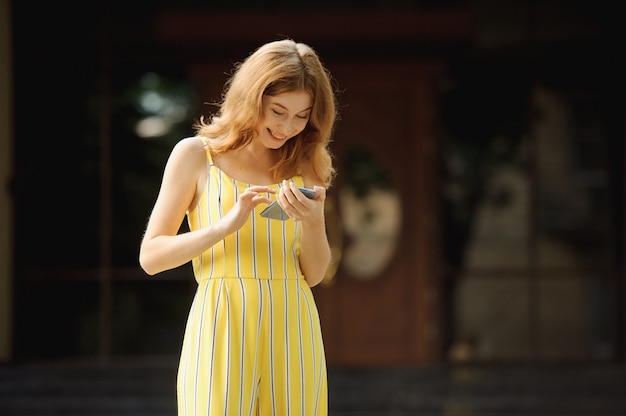 Portrait of beautiful cheerful redhead girl student. Premium Photo