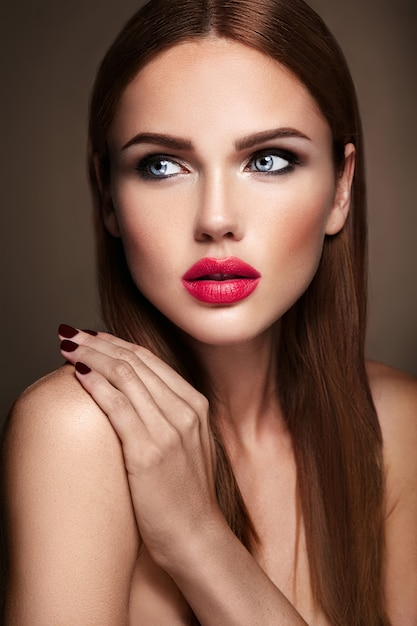Portrait of beautiful girl model with evening makeup and romantic hairstyle. red lips Free Photo