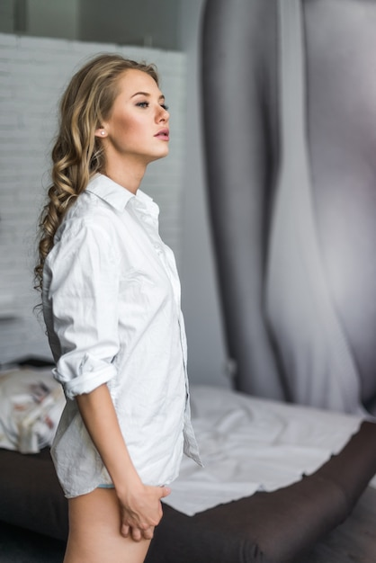 Portrait of a beautiful girl in a white shirt in the morning ...