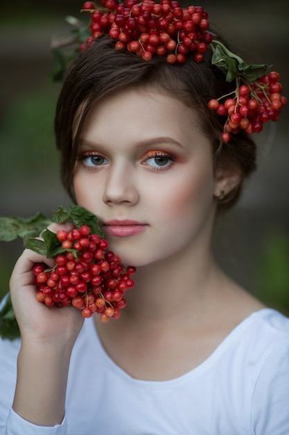 Portrait of a beautiful girl with rowan in her hair Premium Photo