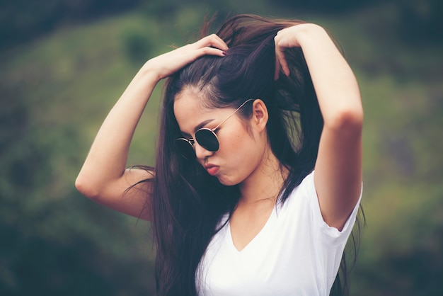 Portrait Of Beautiful Girl Woman Happy With Nature Against Background Of Mountain Premium Photo