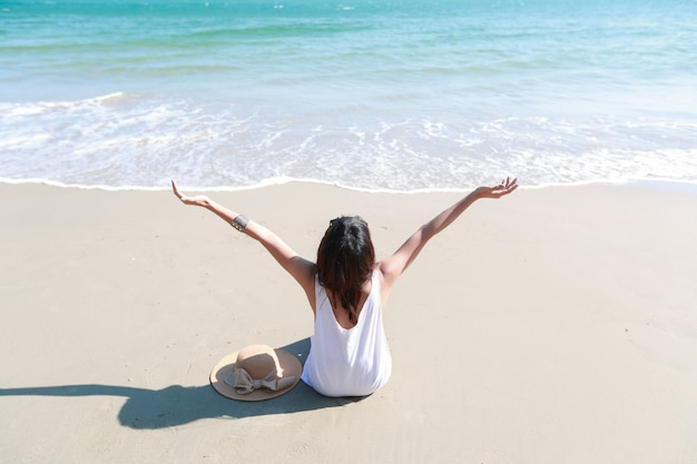 Portrait of beautiful and happiness woman enjoy holiday vacation on the beach Premium Photo