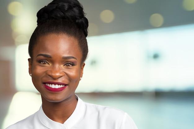 Portrait of beautiful happy black woman standing Premium Photo