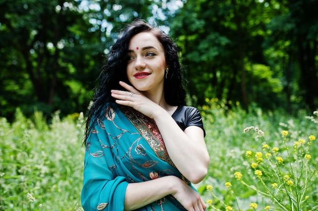Portrait of beautiful indian brumette girl or hindu woman model. traditional indian costume lehenga choli. Premium Photo