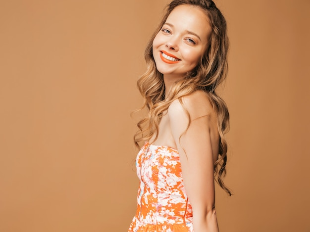 Portrait of beautiful smiling cute model with pink lips. girl in summer colorful dress. model posing Free Photo