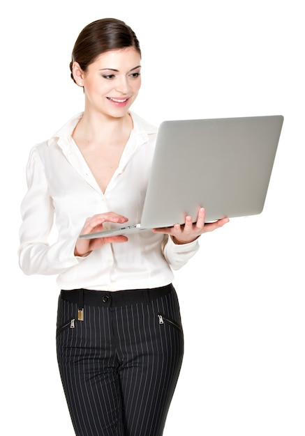 Portrait of a  beautiful smiling woman holds laptop on hands- isolated on white. Free Photo