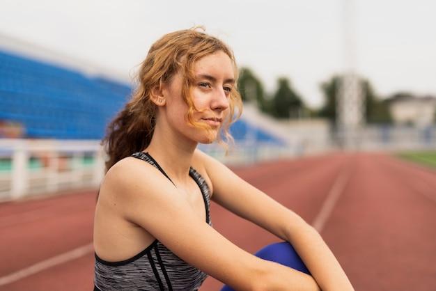 Portrait beautiful sportive woman at stadium Free Photo