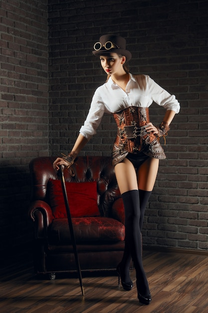 Premium Photo Portrait Of A Beautiful Steampunk Woman In Lingerie And Stockings Hat And Goggles