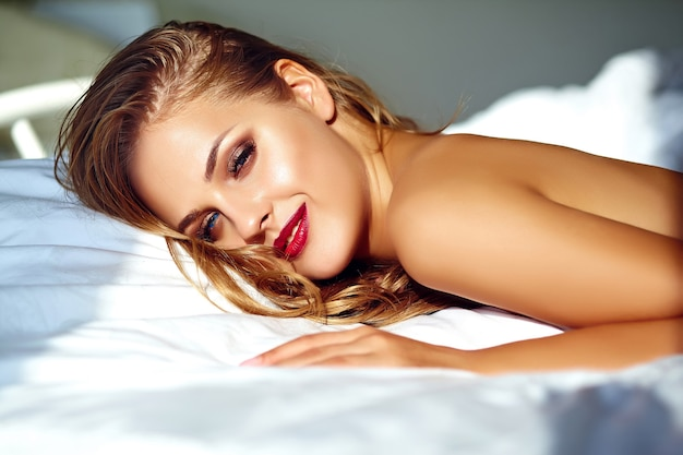 Portrait of beautiful woman on the bed in the morning Free Photo
