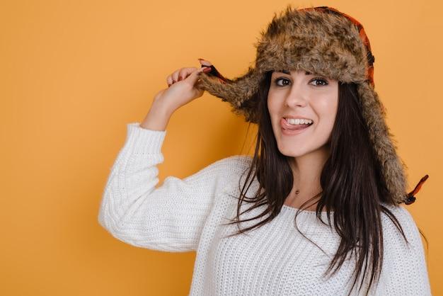 Portrait of a beautiful woman dressed in fur hat in the studio Premium Photo