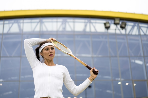 Portrait of beautiful woman playing tennis outdoor Free Photo