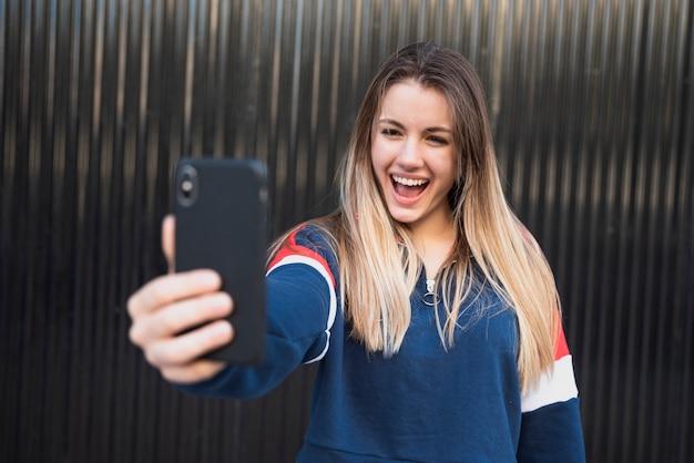 Portrait beautiful woman taking selfie Free Photo