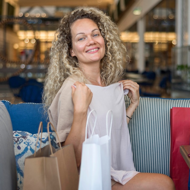 Portrait of beautiful woman trying out new clothes Free Photo