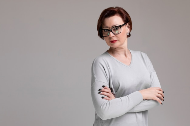 Portrait of beautiful woman with glasses isolated on light Premium Photo