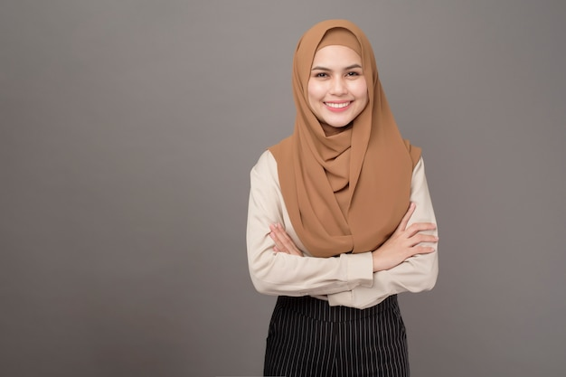 Portrait of beautiful woman with hijab is smiling on gray background Premium Photo