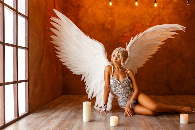 Portrait of beautiful woman with white angel wings on Premium Photo
