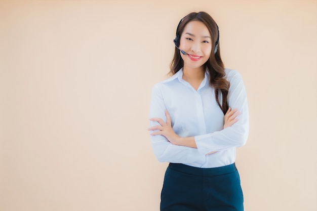 Portrait beautiful young asian business woman with headphone for call center Free Photo