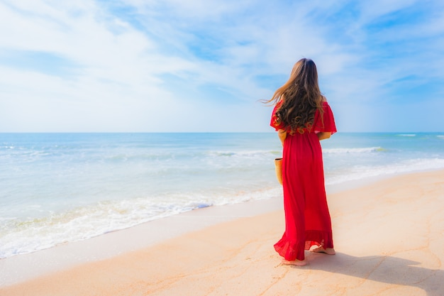 Portrait beautiful young asian woman on the beach and sea Free Photo