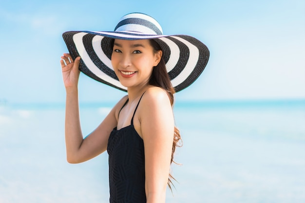 Portrait beautiful young asian woman happy and smile on the beach and sea Free Photo