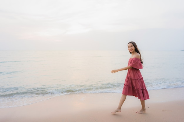 Portrait beautiful young asian woman happy smile leisure on the beach sea and ocean Free Photo
