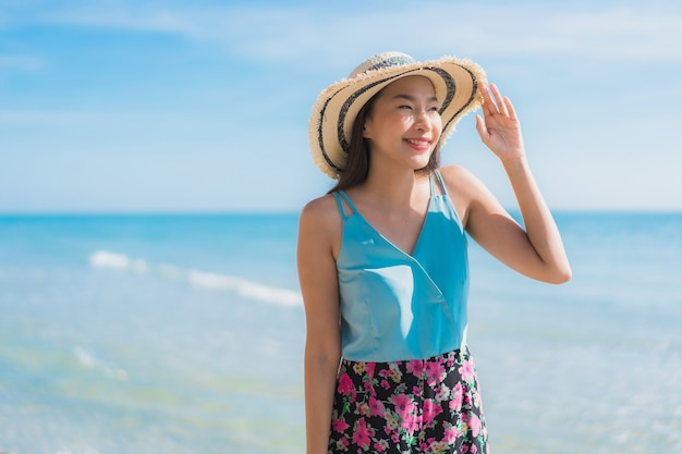 Portrait beautiful young asian woman happy smile relax around beach ocean and sea Free Photo