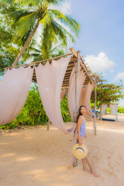 Portrait beautiful young asian woman happy smile relax on the tropical beach sea ocean for leisure travel Free Photo
