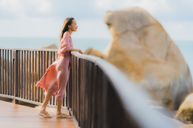 Portrait beautiful young asian woman looking sea beach ocean for relax in holiday vacation travel Free Photo