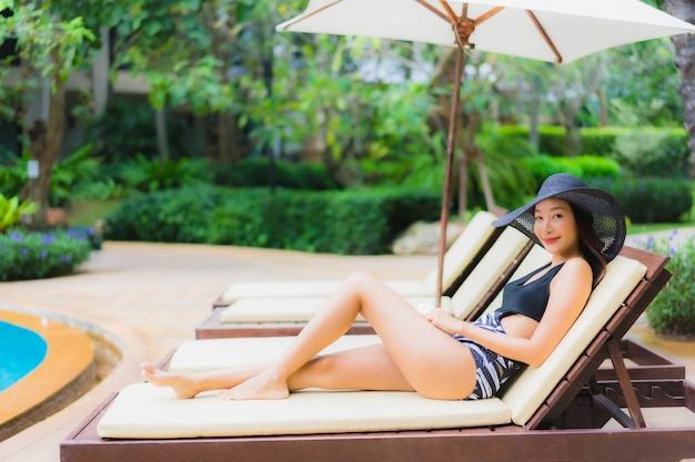 Portrait of beautiful young asian woman near the swimming pool Free Photo