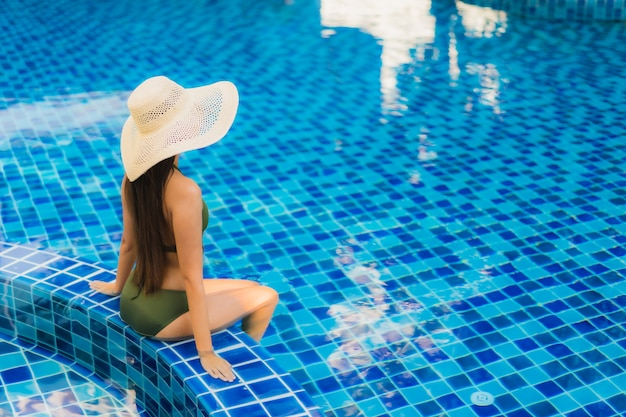 Portrait beautiful young asian woman relax around swimming pool in hotel resort Free Photo