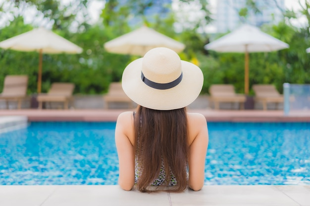 Portrait beautiful young asian woman relaxing outdoor in swimming pool in holiday trip Free Photo