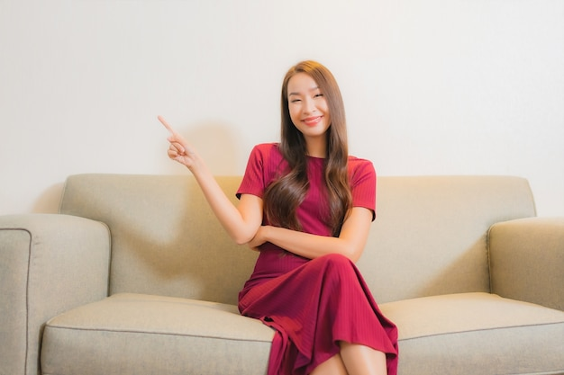 Portrait beautiful young asian woman relaxing on sofa in living room interior Free Photo
