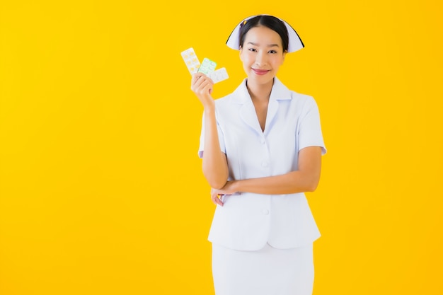 Portrait beautiful young asian woman thai nurse with pill or drug Free Photo