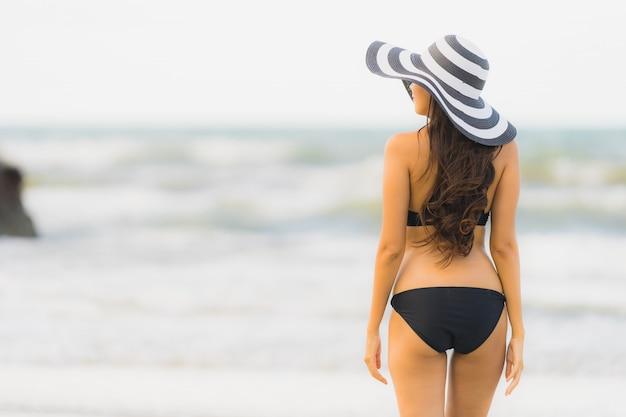 Portrait beautiful young asian woman wear bikini on the beach sea ocean Free Photo
