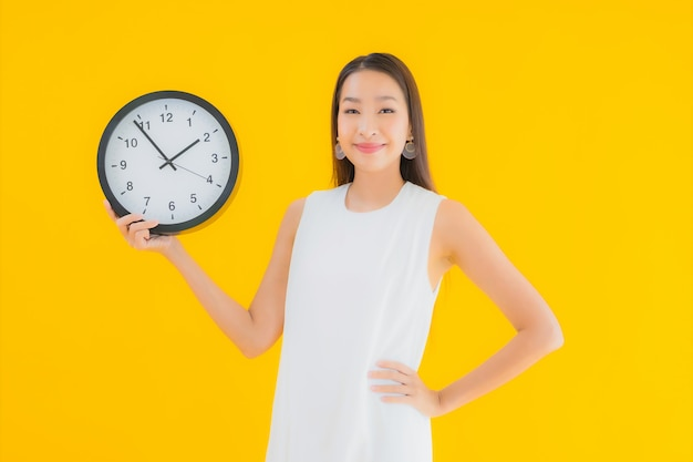 Portrait beautiful young asian woman with alarm or clock Free Photo