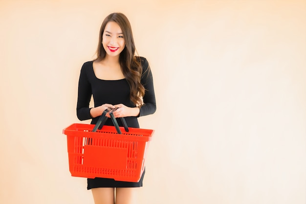 Portrait beautiful young asian woman with grocery basket Free Photo