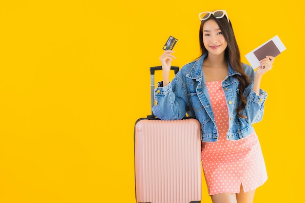 Portrait beautiful young asian woman with luggage travel bag with passport and boarding pass ticket Free Photo