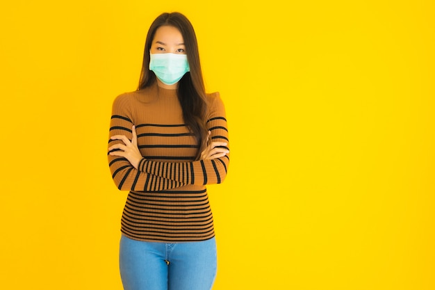 Portrait beautiful young asian woman with mask in many action for protect from coronavirus or covid19 Free Photo