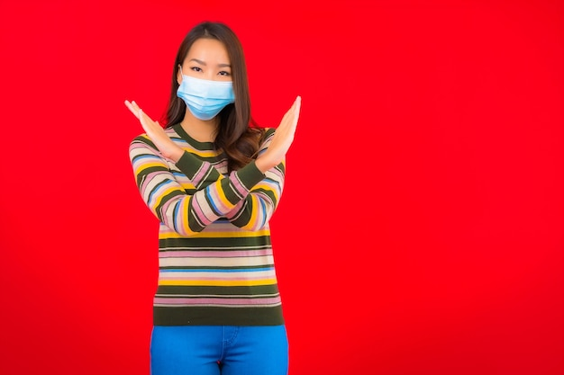 Portrait beautiful young asian woman with mask for protection covid19 Free Photo