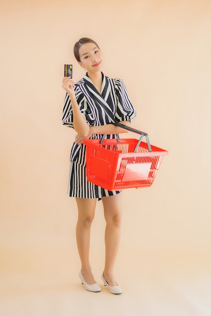 Portrait beautiful young asian woman with shopping basket Free Photo