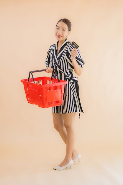Portrait beautiful young asian woman with shopping basket Free Photo