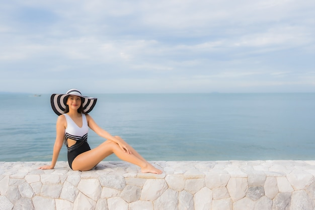 Portrait beautiful young asian women relax smile happy around sea beach ocean Free Photo